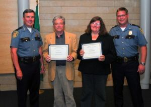 Patrick Sand and Tracy Record receive 2008 Citizen Appreciation Award from Seattle Police Chief Kerlikowske, left, and Southwest Precinct Lt. Steve Paulsen